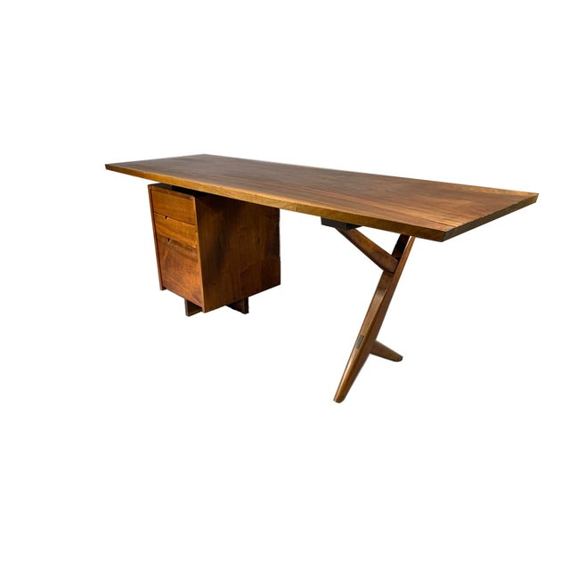 WRITING DESK Circa late 1950s / early 1960s, made by George Nakashima (1905-1990), New Hope, Pennsylvania. American black...