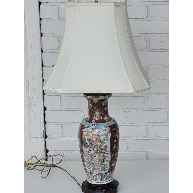 Ornate Hand Painted Chinese Porcelain lamp. Hand-crafted heritage design in the lamp. China trees, people and flowers, and...