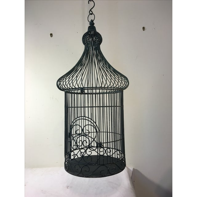 A vintage bird cage. Perfect to use as a container garden. Has a hook for hanging and painted in a blue green color with...