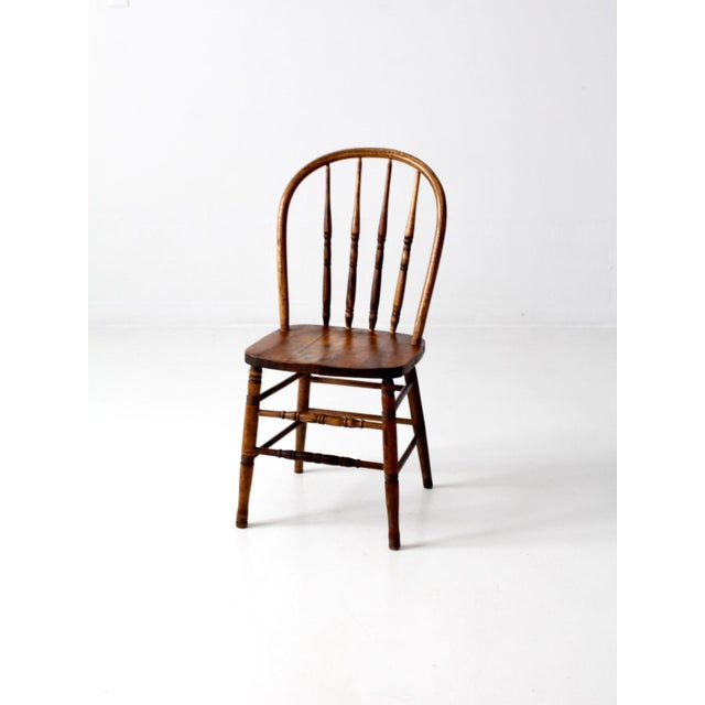 This is an antique spindle back chair. The classic Windsor style farmhouse  chair features turned - Antique Spindle Back Dining Chair Chairish