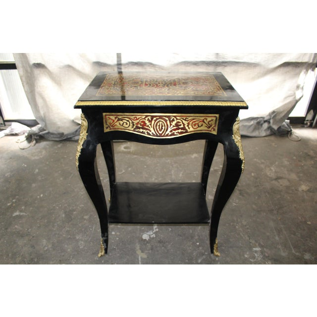 Fit for all occasions and spaces, this pair of French Boulle square-top tables stand on cabriole legs and are beautifully...