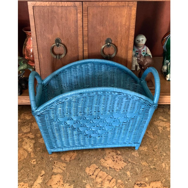 Offering this classic woven wicker magazine holder in an unexpected rich blue hue. A practical piece with that pop of...
