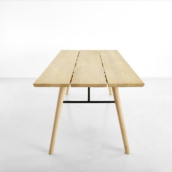 The Split table is a Scandinavian interpretation of a classic plank table. The masculine table top is made of three solid...