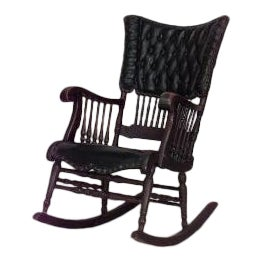 American Victorian oak and black tufted leather rocking chair with spindle design For Sale