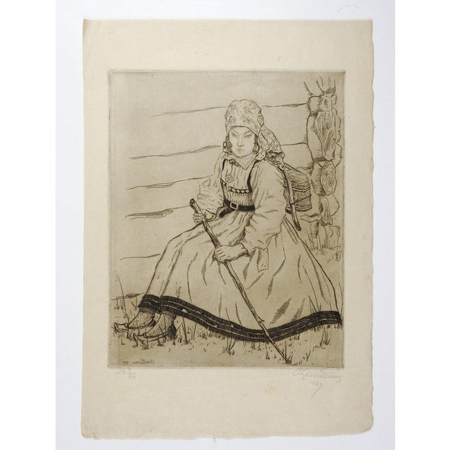 Etching on paper of young woman in traditional dress by Olof Abrahamsen Willums (1886-1967) Norway. Signed, numbered 2/36...
