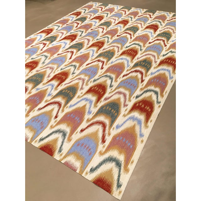 A hand woven ikat design wool flatweave. Ikat is the name for indonesian tie dyed fabrics. This rug design personifies...