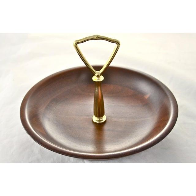 Midcentury vintage turned wood bowl with gold tone center handle. No maker's mark. Light wear.