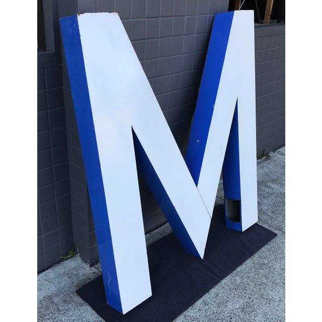 """A large vintage Blue and White enameled """"M"""" outdoor building signage. Same as the letters you would find on old commercial..."""