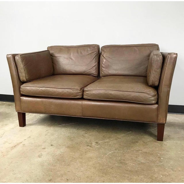 Danish modern 2 seater leather sofa that's in the style of Børge Mogensen. This loveseat with wonderful patina is great to...