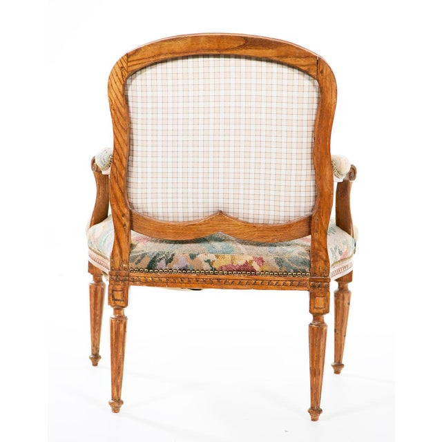 Louis XV style carved beechwood armchair made in the 19th century, probably in Italy.