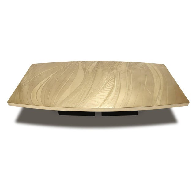 Shown with an hand acid etched bronze top which sits on a lacquered steel base, the Surf table's dimensions can be...