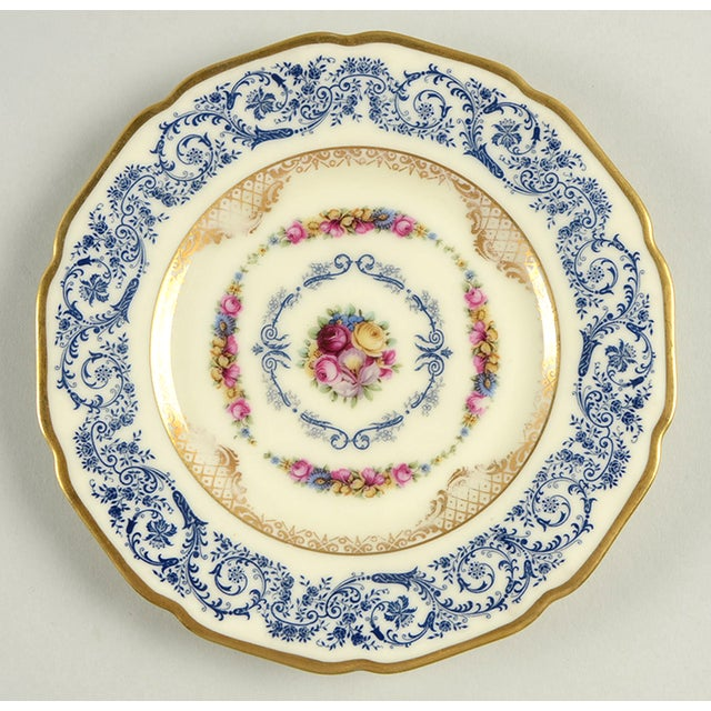 Black Knight Margarite Bread Plate S/4 features a detailed blue scroll rim design, floral bouquet center, delicate gold...