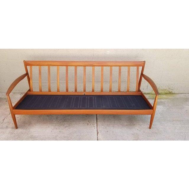 Teak Danish modern sofa designed by Grete Jalk for France & Daverkosen, Denmark, 1960s. Warm tone to teak frame. Clearly...