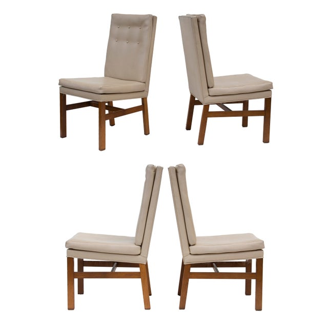 Set of four tufted midcentury dining chairs with high backs and solid oak frames. These are in original upholstery with...