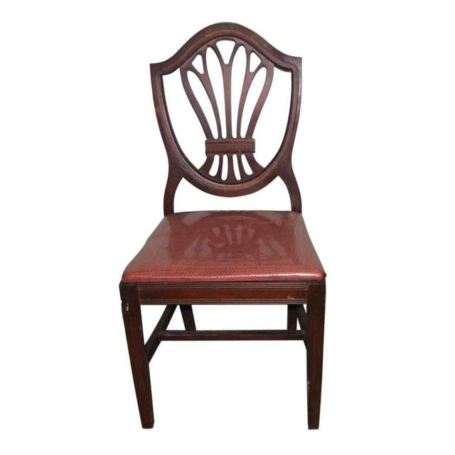 Classic mahogany vintage chairs. The upholstery has been well preserved by a vinyl cover. The wood is sturdy, but the...