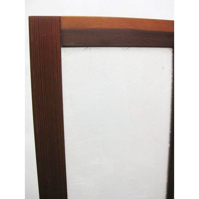 White textured fiberglass with teak hinged folding screens or room dividers.