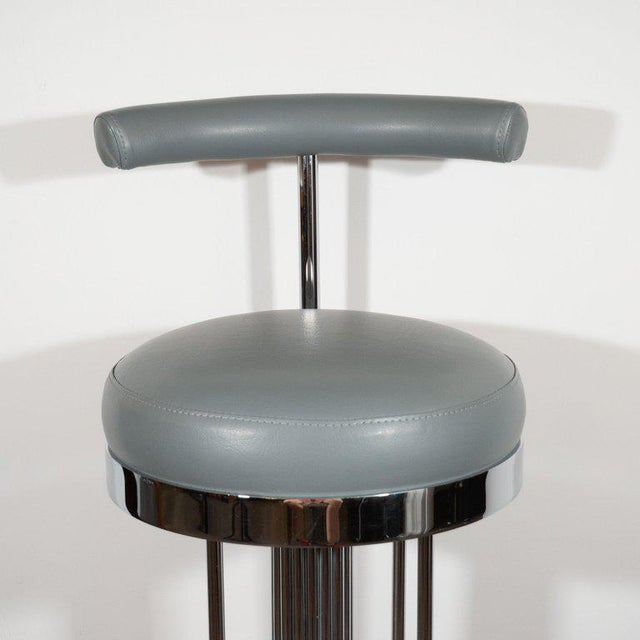 This sculptural and elegant set of three mid-century modern bar stools were realized in the United States, circa 1970....