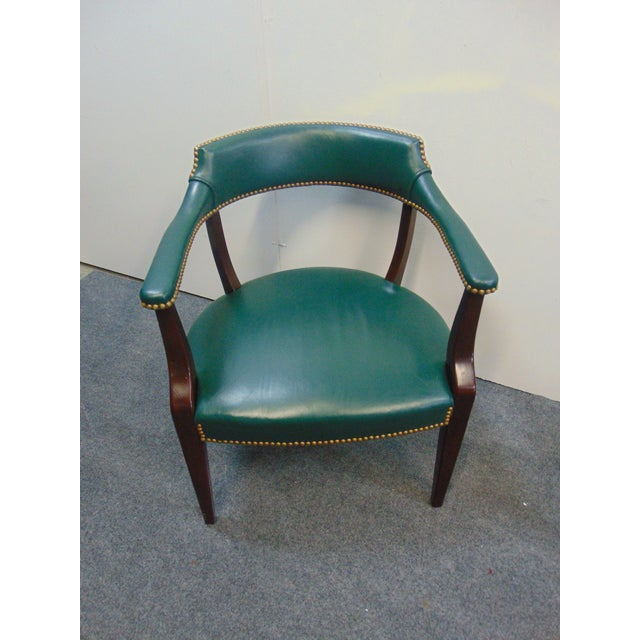 Modern office desk chair , solid mahogany frame with forest green leather upholstery, brass nailhead trim