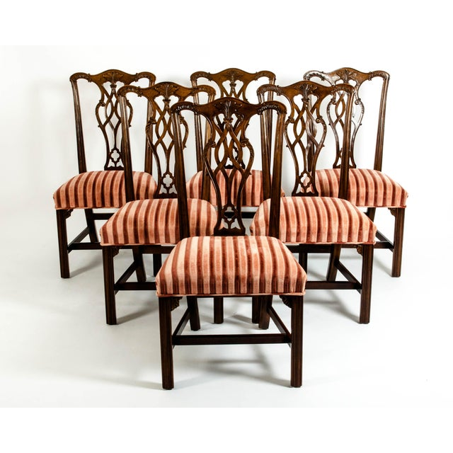 Set of eight Georges III style mahogany dining chairs. Six side chairs and two armchairs. Each chair is in excellent...