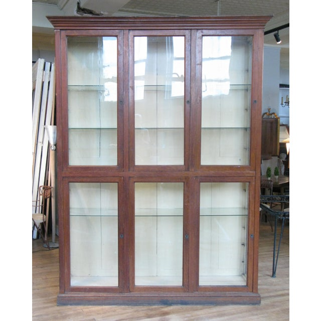 A very handsome antique late 19th century display cabinet with an oak case and glass doors and side lights. The interior...