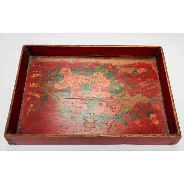 Late 19th century antique wood serving tray hand painted with flowers on red background. Worn paint and great patina with...