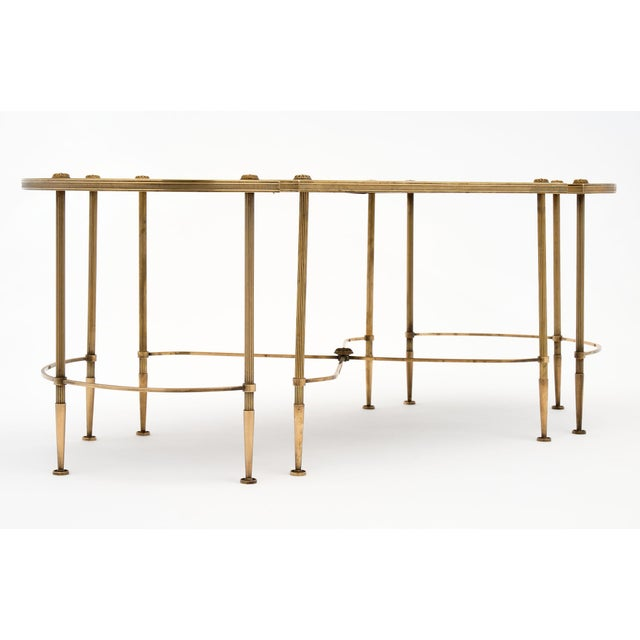 Maison Baguès three part coffee table made of gilt brass and antiqued mirror. This piece has a center square table flanked...