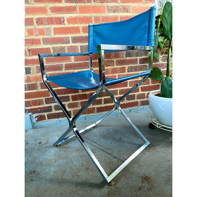 Excellent vintage Milo Baughman director's chair. Chrome base and armrests and blue leatherette seat and backrest. This...