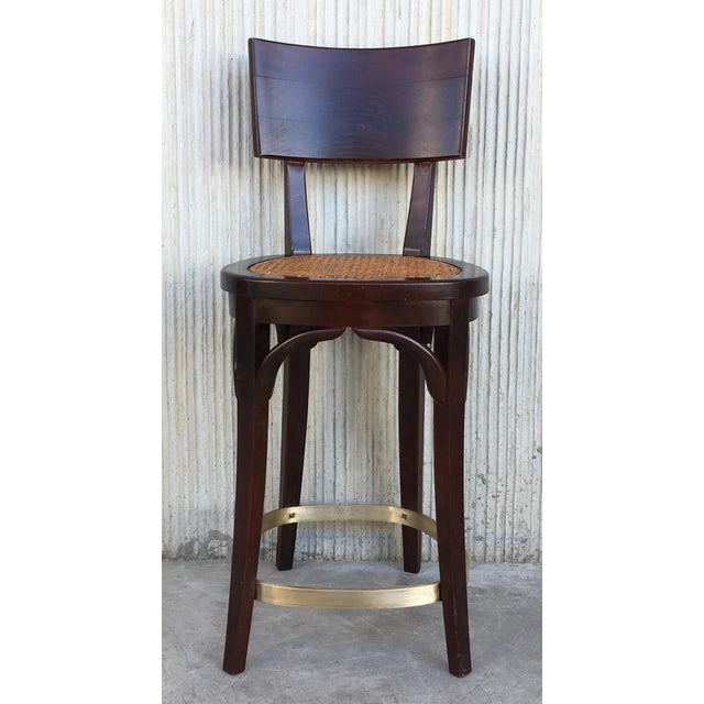 About A set of six 1940s Italian-made round bar-height stools Each stool has four rounded saber legs and reinforcements...