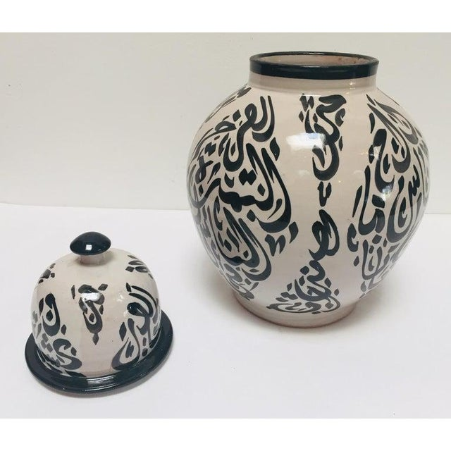 Moroccan Ceramic Lidded Urn With Arabic Calligraphy Lettrism Black Writing For Sale - Image 9 of 12