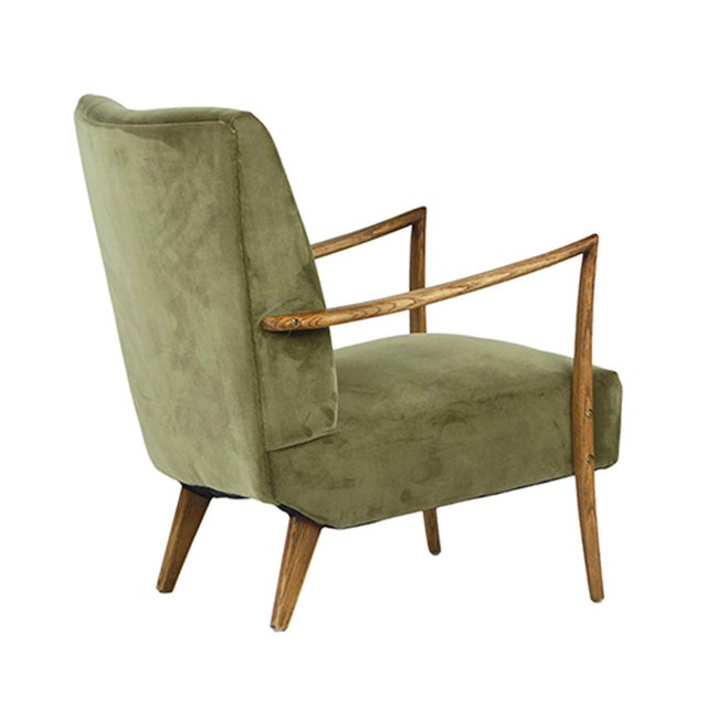 Midcentury style arm chair with green velvet upholstery and solid hardwood arms and legs. Comfy retro yet modern chair for...