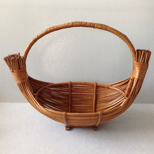 """High quality handmade basket. Measures 14"""" tall, 9"""" x 18"""" wide. Made in Madeira."""