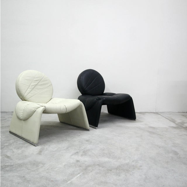 Black and white never looked so good. This Pair of Black and White Leather Vintage Italian Lounge Chairs are incredible....