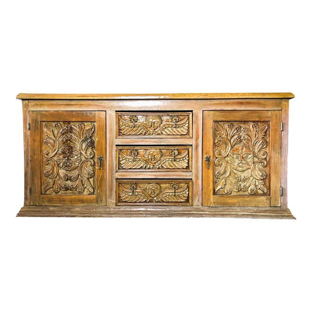 Antique Mexican Hand Carved Wood Sideboard With Cherubs and Green Man Motif For Sale