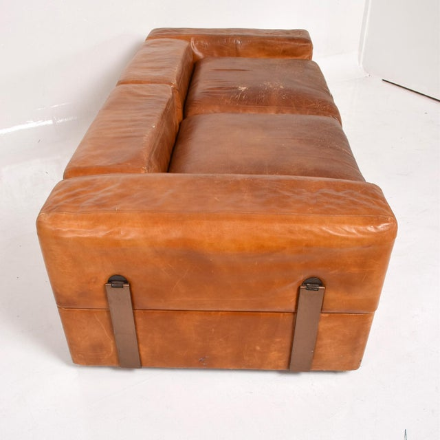For your consideration a unique sofa bed. Made in Italy circa 1960s. Patinated bronze hardware. Leather has original...