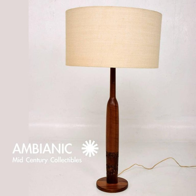 For your consideration a teak and cork table lamps with sculptural shape. Rewired. No markings from the maker. Shade not...