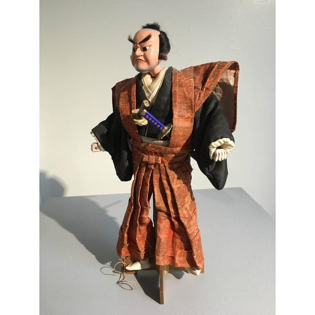 Created for Bunraku theatre, this Bunraku, known in Japan as a Ningyo Jorurui, depicts a samurai warrior. He is dressed in...