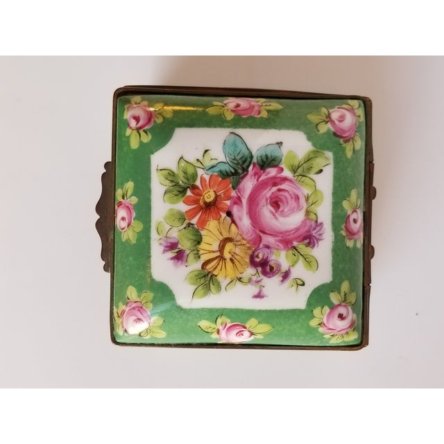 Very charming antique French bronze mounted floral and rose bud motif hand painted trinket box. One unidentified mark on...
