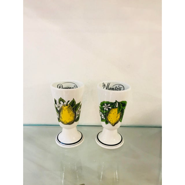 A pair of French Cups with lemon decoration and lleaves.