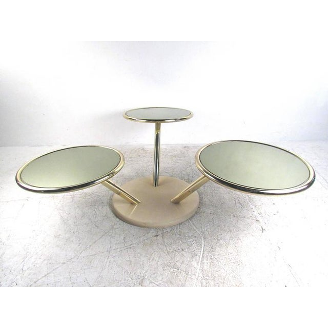 This beautiful vintage three-tier swivel table features unique brass frame with mirrored glass table tops. Stylish design...