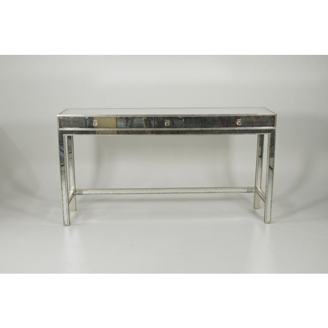 Mirrored modern console table By John Richard. The silver gilt body with distressed mirrored surface.