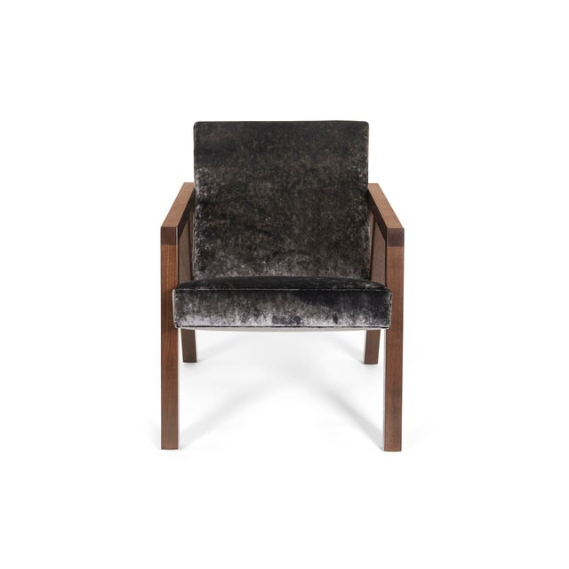 The moda chair is both timeless and modern. With sleek, angular walnut arms and legs and plush velvet upholstery, it...