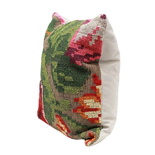 Floral fragments from a vintage flat-weave kilim have been crafted into a set of beautiful throw pillows. Both classic and...