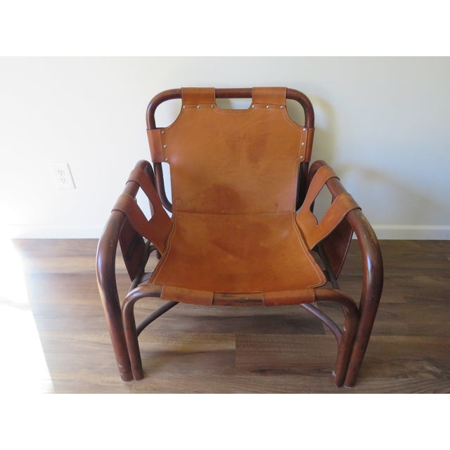 Unique Mid-Century Arne Norell style safari chair. Light weight bamboo frame with leather seat, arms, and back. Made in...