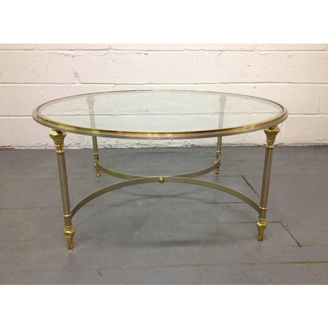 Brass and steel round coffee table with glass top.