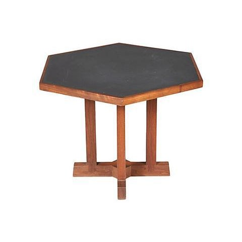Vintage six sided slate top table on a dovetailed walnut base, circa 1960. No maker's mark. Light wear to the slate top....