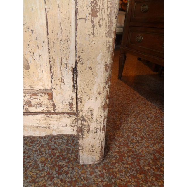 This is a great medium sized one door cabinet with distressed painting ranging from white to pale yellow. Late 19th...
