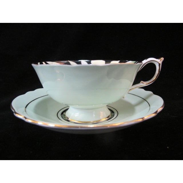 English Mid 20th Century Paragon Yellow Daffodil Black Interior Pedestal Cup & Mint Saucer Gilt Trim Set For Sale - Image 3 of 9