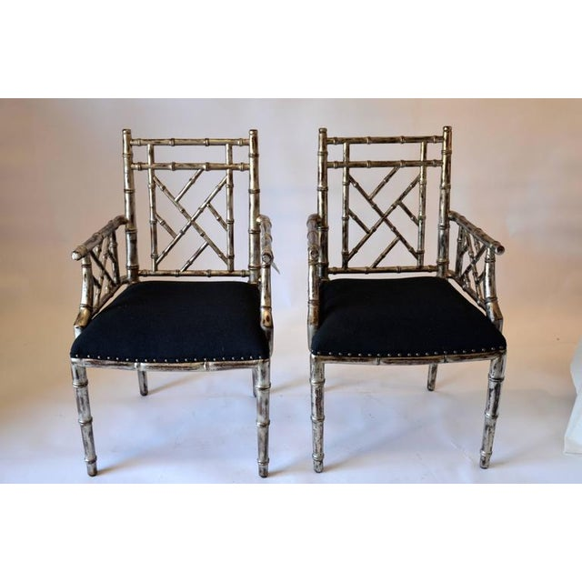 This is a pair of vintage rogue silver gilt chairs with black upholstery. There are 2 pairs available, $2350 per pair.
