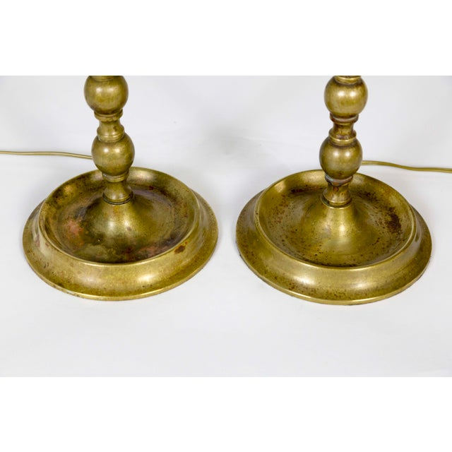 """An elegant pair of solid brass, traditional, American Colonial candlesticks as lamps. 22"""" to top of the socket, base..."""