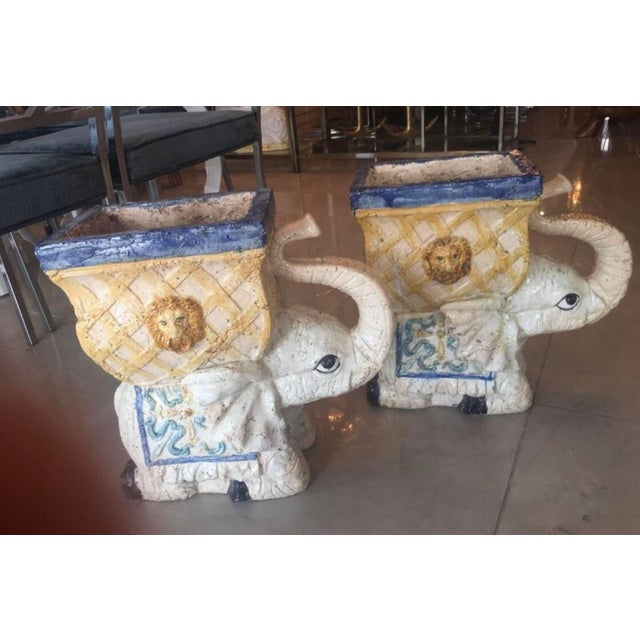 The most wonderful pair of old Italian elephant garden plant stands. I believe these are some sort of terra cotta with a...